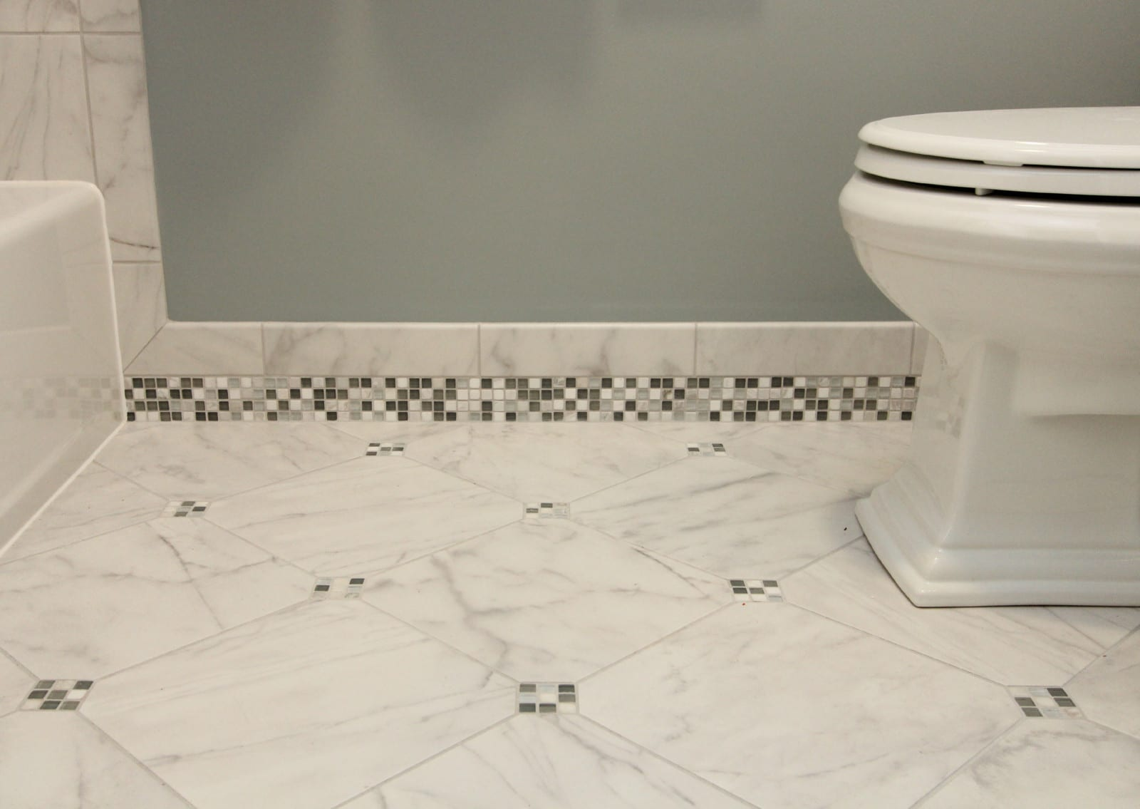 Bathroom Renovation - Cool Tones with Mosiac Tile Baseboards