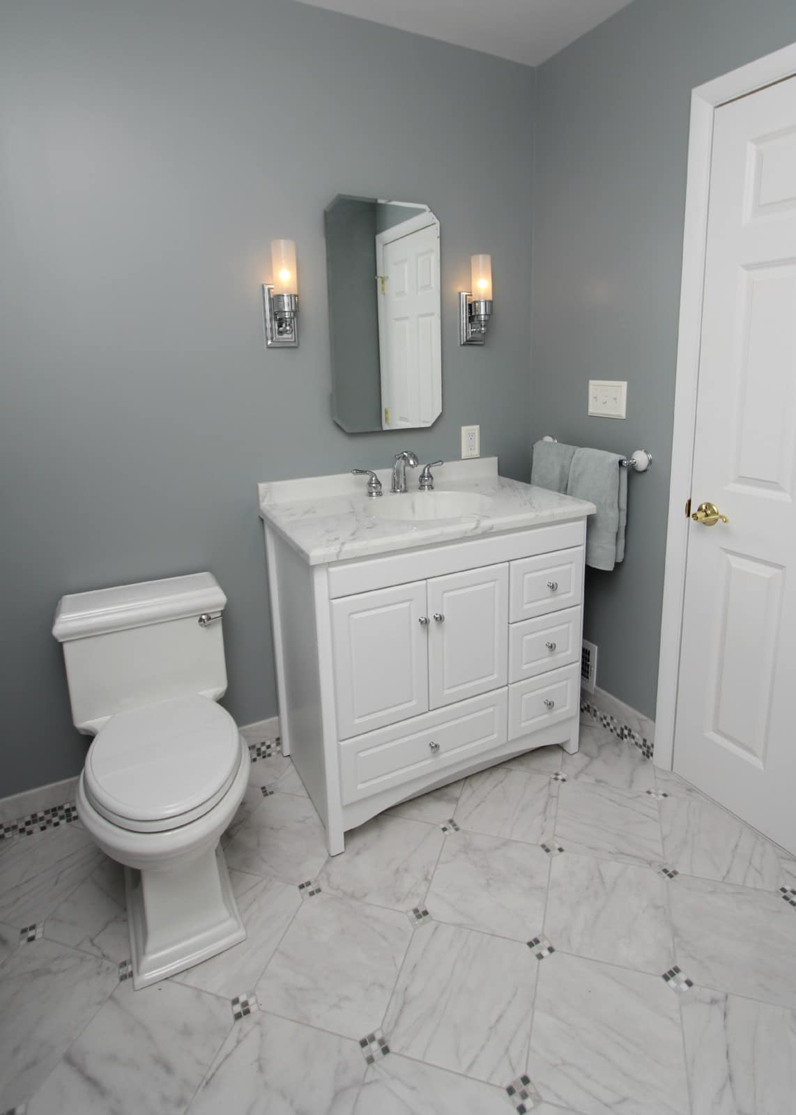 Bathroom Renovation Cool Tones With Mosiac Tile Baseboards
