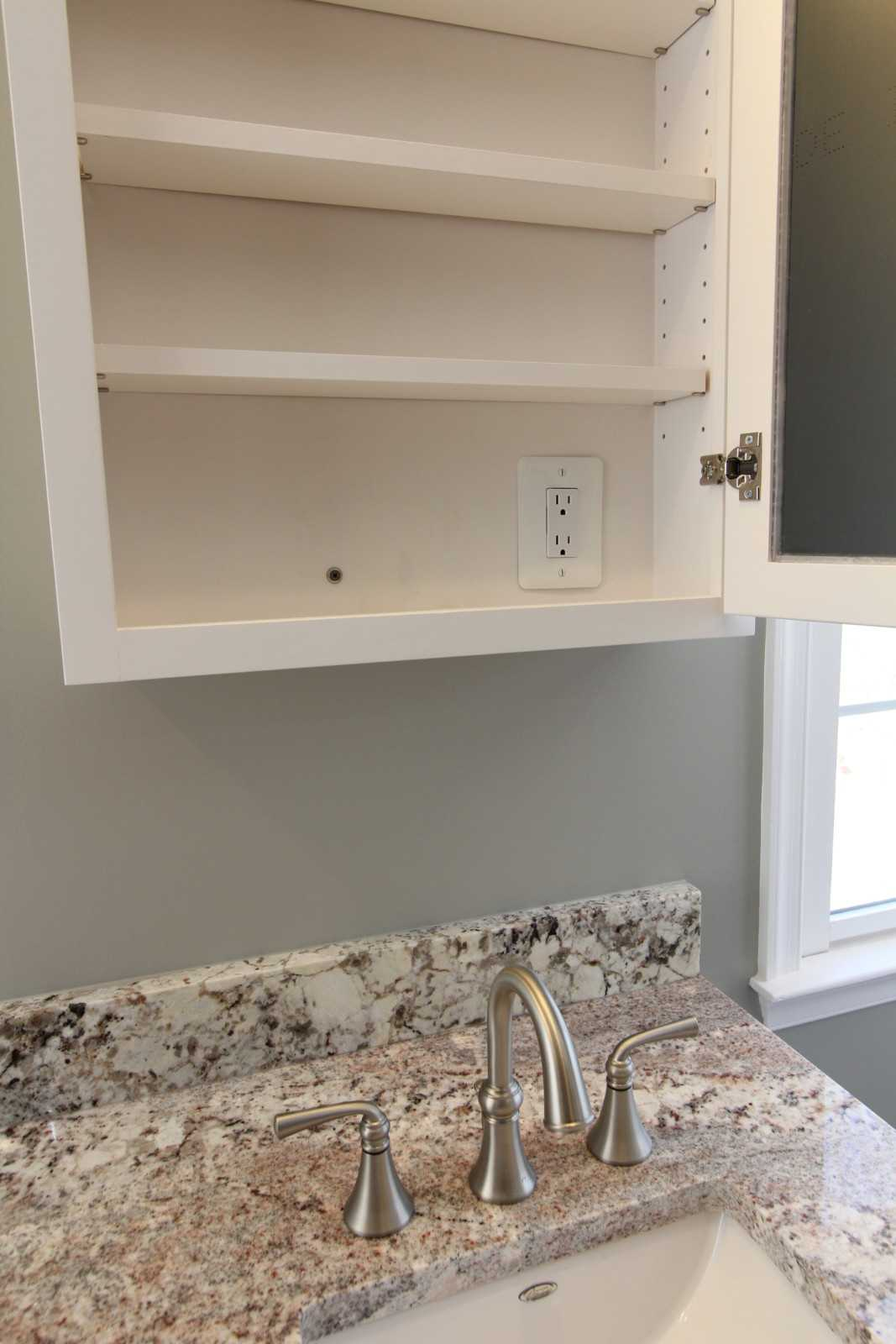 custom bathroom cabinet with outlet